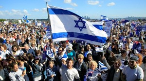 Jewish people holds an Israeli flag