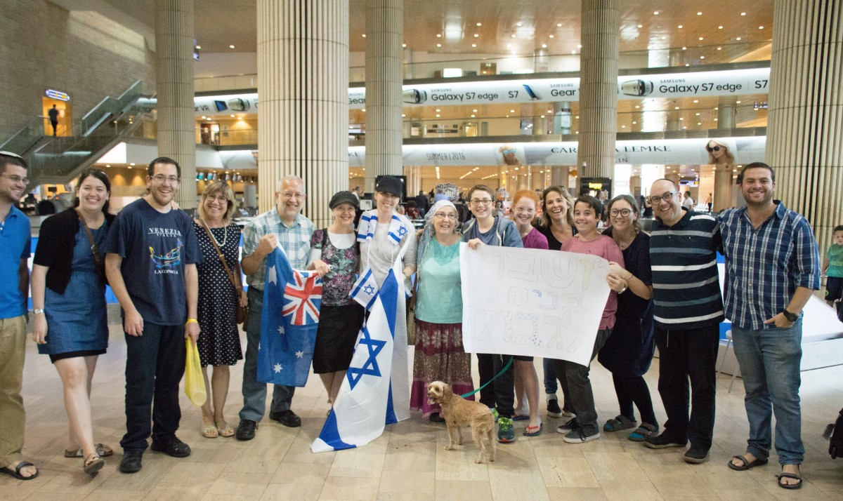 Jewish people with an Israeli flag in the airport